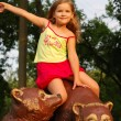 Stock Photo: The little girl on a brown bear