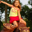 The little girl on a brown bear — Stock Photo