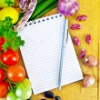 Notepad with vegetables — Stock Photo #7174096