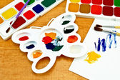 Paint palette and on the board — Stock Photo