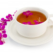 Herbal tea in a white cup with fireweed — Stock Photo