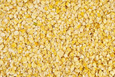The texture of the yellow pea flakes — Stock Photo