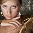 Elegant woman and gold jewelry — Foto Stock
