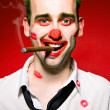 Clown smoking cigaro — Stock Photo