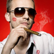 Stock Photo: Man smoking cigar