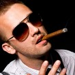 Foto Stock: Man smoking cigar