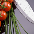 Fresh tomatoes and knife — Stock Photo