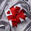 Gift on silver background — Stock Photo