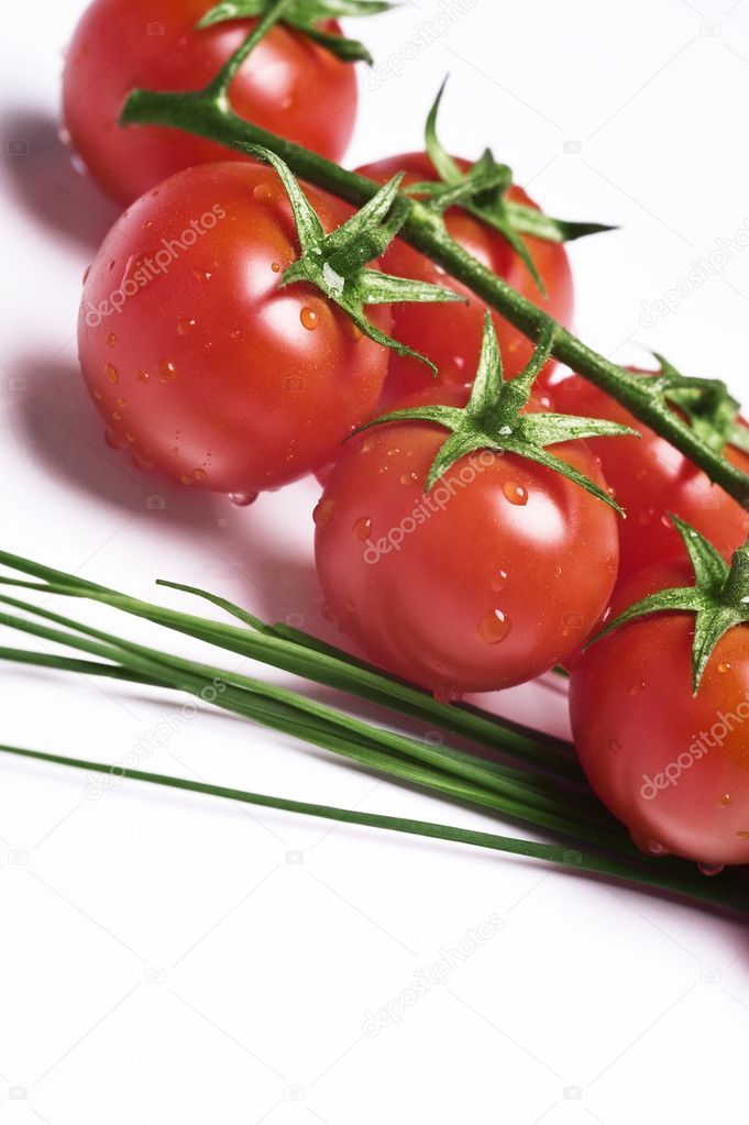Fresh wet tomatoes and chive on table — Stock Photo #6874638