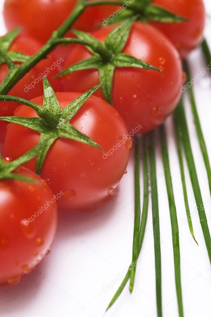 Fresh wet tomatoes and chive on the table — Stock Photo #6874644