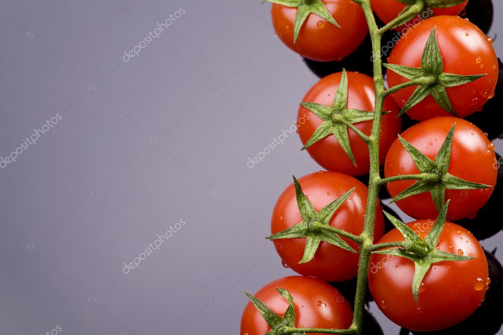 Fresh wet tomatoes on the black table — Stock Photo #6874663