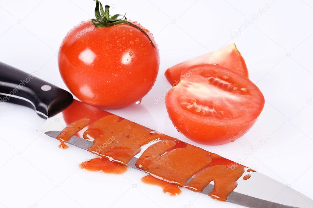 Tomatoes and knife stained with ketchup over white  Stock Photo #6874701