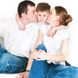 Parents kiss the son — Stock Photo