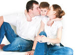 Parents kiss the son — Stock Photo