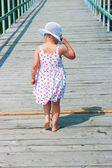 Girl going on a pier — Stock Photo