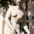 Stock Photo: Burst of naked lady sculpture