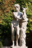 Naked young man sculpture with deer — Stockfoto