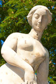 Burst of naked lady sculpture — Stock Photo
