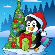 christmas scene with penguin — Stock Vector
