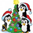 Three penguins with Christmas tree — Stock Vector