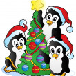 Three penguins with Christmas tree — Stock Vector #7213987
