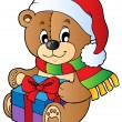 Christmas teddy bear with gift — Stock Vector
