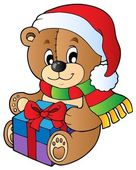 Christmas teddy bear with gift — Stock Vector
