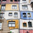 The Hundertwasserhaus is an apartment house - Stock Photo