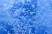 Frosty natural pattern on winter glass with drops — Stock Photo