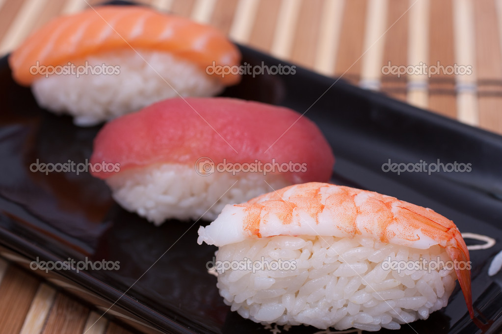 Fish sushi set on sushi plate. Selective focus. — Stock Photo #6850063