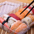 Foto de Stock  : Sushi set with sticks