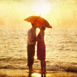 Stock Photo: Couple kissing at the beach in sunset.