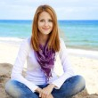 Young beautiful girl at the beach. — Stock Photo