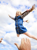 Little girl fly in the sky — Stock Photo
