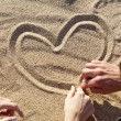Drawing heart at sand — Stock Photo