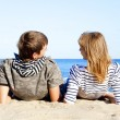 Happy pair of male and female on coast behind blue sea — Stock Photo #7194984