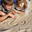 Drawing heart at sand — Stock Photo #7194998
