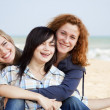 Three girls at outdoor near beach. — Stock Photo