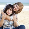 Two girls at outdoor near sea — Stock Photo