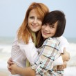 Two girls at outdoor near sea — Stock Photo #7195240