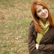 Beautiful girl at outdoor in autumn time — Stock Photo