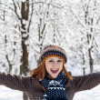 Beautiful young red-haired woman in winter park — Stock Photo #7317193