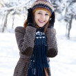 Beautiful young red-haired woman in winter park — Stock Photo #7317195