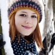 Beautiful young red-haired woman in winter park — Stock Photo #7317202