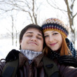 Beautiful couple make photo of themself in winter park. — Stock Photo