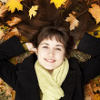 Stock Photo: Portrait of brunette girl in the autumn park.