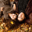 Royalty-Free Stock Photo: Couple lying in the park in fall