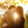 Couple kissing in the park at sunset — Stock Photo #7413159