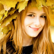 Smiling happy girl in autumn leaves. — Stock Photo