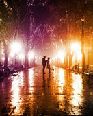 Couple walking at alley in night lights. — Stock Photo